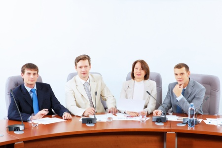 Image of four businesspeople discussing at meeting Stock Photo - 17494609