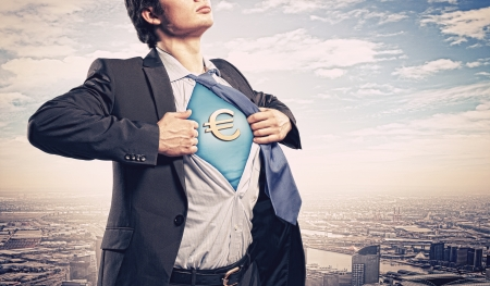 Image of young businessman in superhero suit with euro sign on chest Stock Photo - 17494720