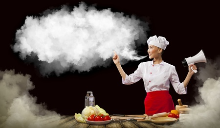Asian female cook holding megaphone with space for text Stock Photo - 17494452