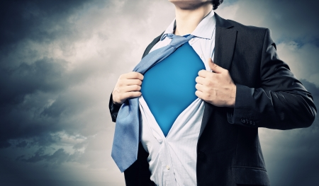transform: Image of young businessman showing superhero suit underneath his shirt
