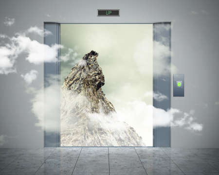 the elevator doors and the natural landscape behind them photo