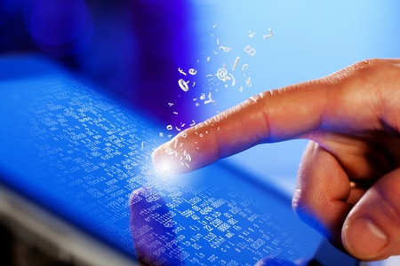 Closeup of finger touching blue toned screen on tablet-pc Stock Photo - 17494847