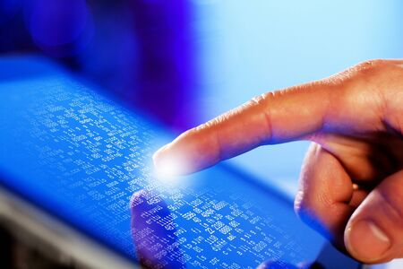 Closeup of finger touching blue toned screen on tablet-pc Stock Photo - 17494834