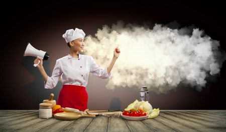Asian female cook holding megaphone with space for text Stock Photo - 17494493