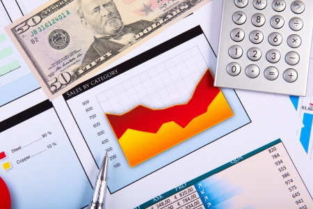 Financial paper charts and graphs on the table Stock Photo - 17494822
