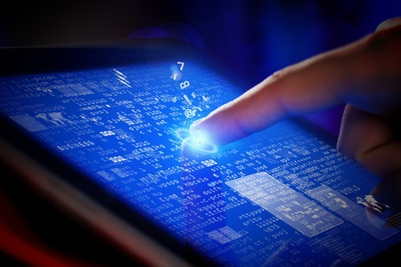 Closeup of finger touching blue toned screen on tablet-pc Stock Photo - 17494823