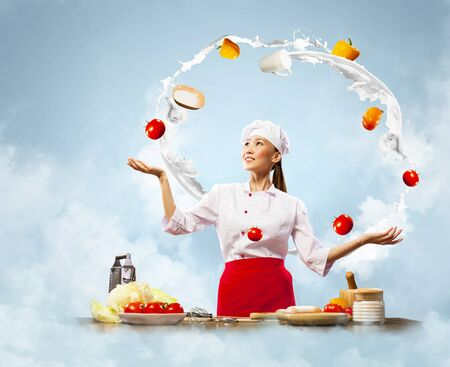 juggler female asian cook against color background photo