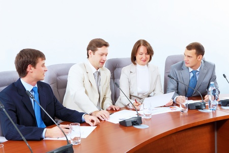 Image of four businesspeople discussing at meeting Stock Photo - 17493830