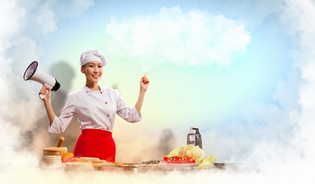 Asian female cook holding megaphone with space for text Stock Photo - 17522130