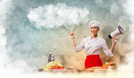 Asian female cook holding megaphone with space for text Stock Photo - 17532596