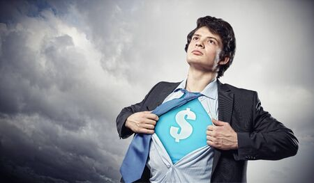 Image of young businessman in superhero suit with dollar sign on chest photo