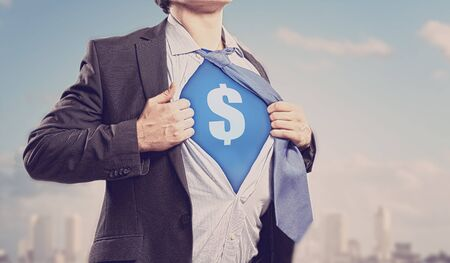 Image of young businessman in superhero suit with dollar sign on chest Stock Photo - 17533443
