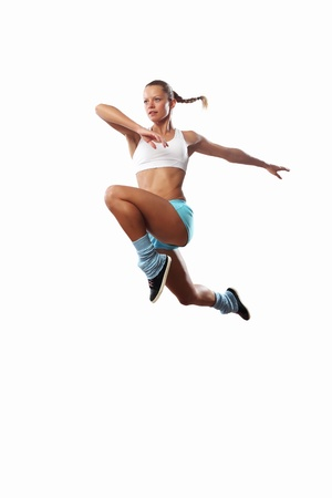 inair: Image of sport girl in jump against white background