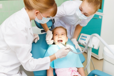 dental clinic: Little girl sitting in the dentists office