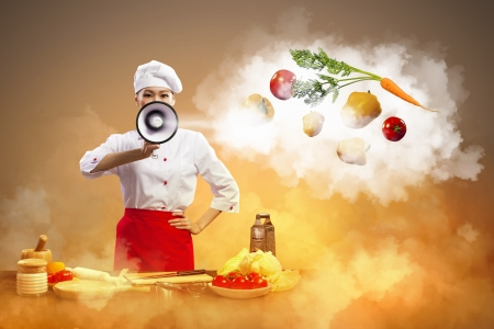 Asian female cook holding megaphone vegetables flying in air Stock Photo - 17531403