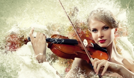 Image of beautiful female violinist playing with against colorful background Stock Photo - 17532352