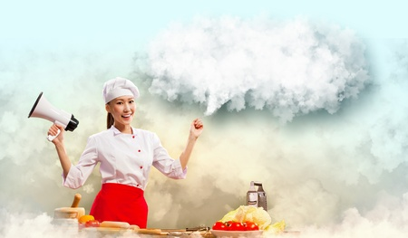 Asian female cook holding megaphone with space for text Stock Photo - 17524541