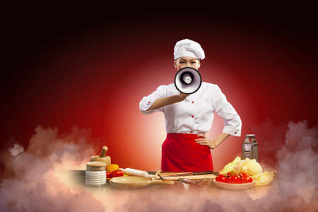 Asian female cook screaming loud in megaphone Stock Photo - 17524897