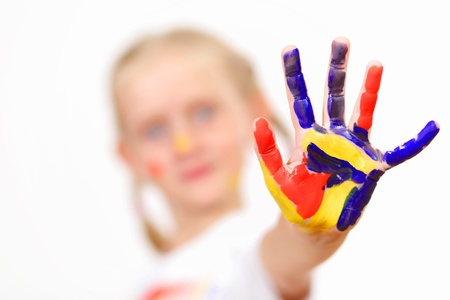 little child with hands painted in colorful paints ready for hand prints Stock Photo - 17521776