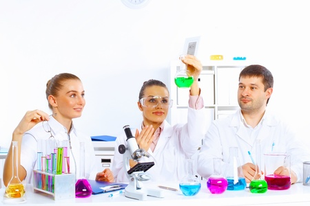Team of scientists working with liquids in laboratory Stock Photo - 17531370