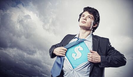 Image of young businessman in superhero suit with dollar sign on chest Stock Photo - 17533988