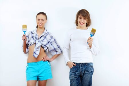 Portrait of young couple with paint brushes Stock Photo - 17578821