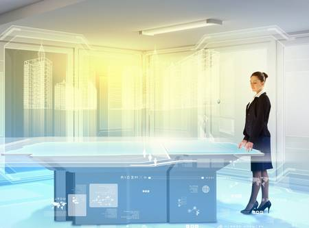 aside: Image of young businesswoman standing aside of high-tech picture