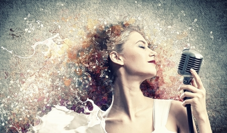 Image of female blonde singer holding microphone against color background with closed eyes Stock Photo - 17579111