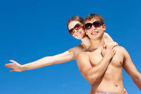 Portrait of a happy young couple enjoying at beach Stock Photo - 17578823