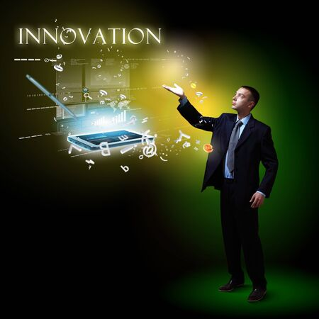 Businessman standing with modern technology symbols next to him Stock Photo - 17578849