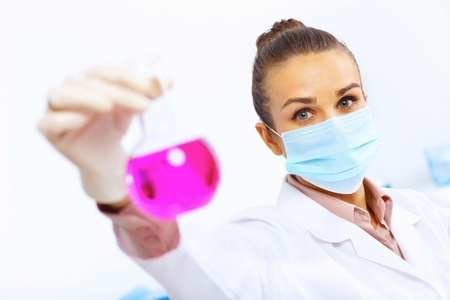 Young female scientist working with liquids in laboratory Stock Photo - 17578766