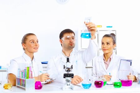Team of scientists working with liquids in laboratory Stock Photo - 17578751