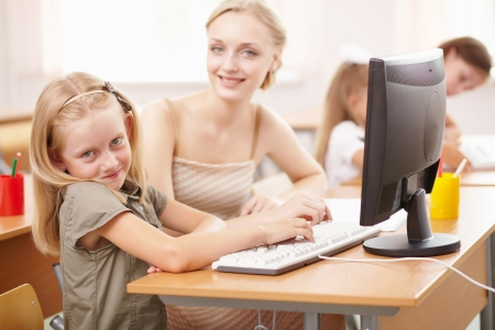 Little girl sitting and studying at school class Stock Photo - 17578851