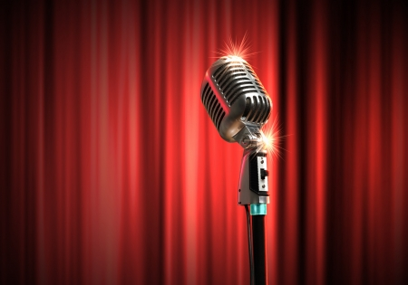 Single retro microphone against red curtains closed on the background Stock Photo - 17579144