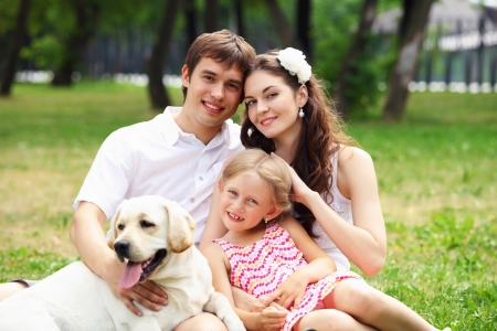 Young Family Outdoors in summer park with a dog Stock Photo - 17578847