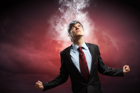 amok: businessman in anger with fists clenched and steam above head