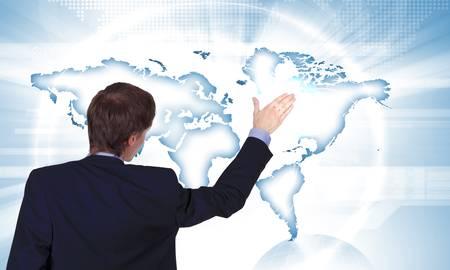 Modern Business World, A businessman navigating virtual world map Stock Photo - 17616804
