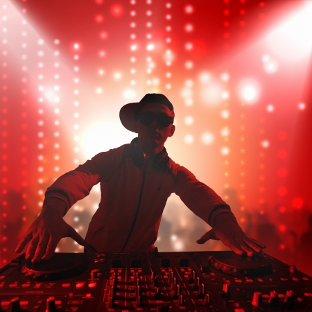 disc jockey: DJ with a mixer equipment to control sound and play music Stock Photo