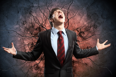 amok: businessman in anger with fists clenched screaming Stock Photo