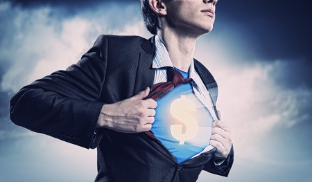 Image of young businessman in superhero suit with dollar sign on chest Stock Photo - 17669878