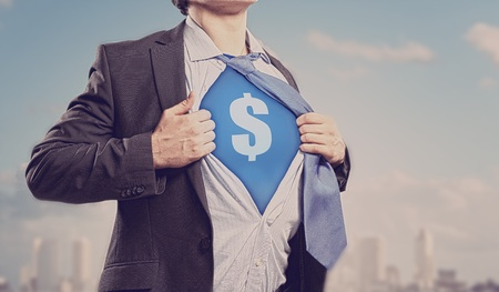 Image of young businessman in superhero suit with dollar sign on chest Stock Photo - 17669883