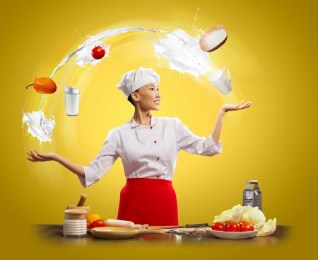 juggler female asian cook against color background photo