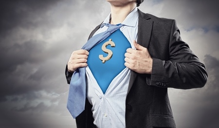 Image of young businessman in superhero suit with dollar sign on chest Stock Photo - 17669896