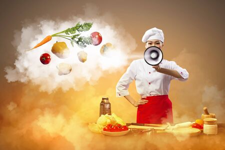 inair: Asian female cook holding megaphone vegetables flying in air