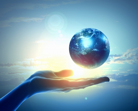 hands holding globe: Image of hand holding earth planet against illustration background