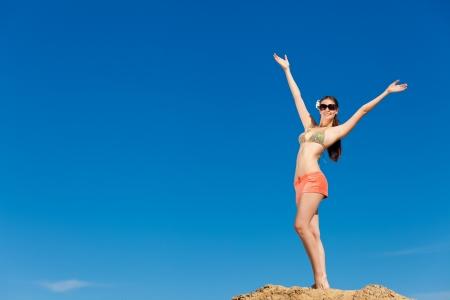 Fashion shot of beautiful woman on the beach photo