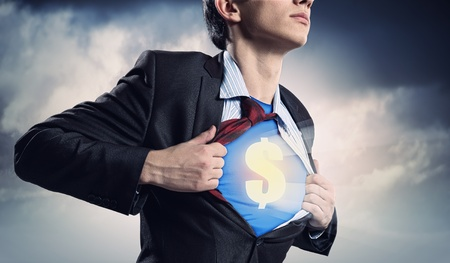 Image of young businessman in superhero suit with dollar sign on chest Stock Photo - 17760165