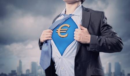moneymaking: Image of young businessman in superhero suit with euro sign on chest