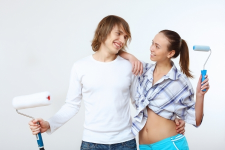 Portrait of young couple with paint brushes Stock Photo - 17760384