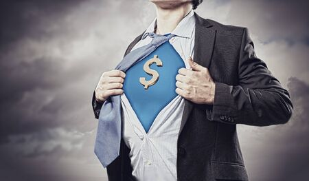 Image of young businessman in superhero suit with dollar sign on chest Stock Photo - 17760462